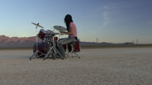 female playing drums in desert - drummer stock videos & royalty-free footage