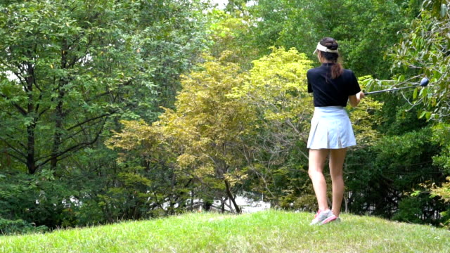 female  playing golf at the driver range - golf swing women stock videos & royalty-free footage