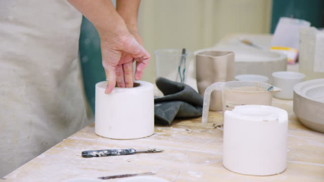 female potter making ceramic cups in pottery workshop - moulding a shape stock videos & royalty-free footage