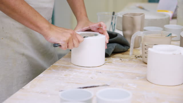 female potter making clay pots in pottery studio - ceramics stock videos & royalty-free footage