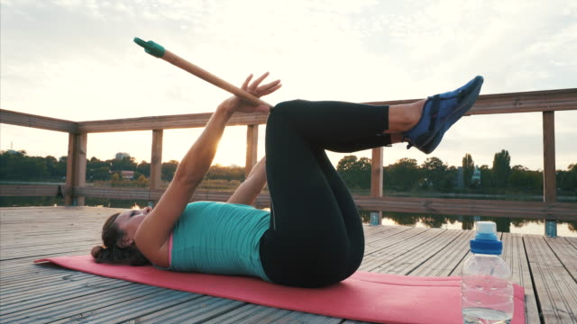 female practicing pilates outdoor. - abdominal muscle stock videos & royalty-free footage