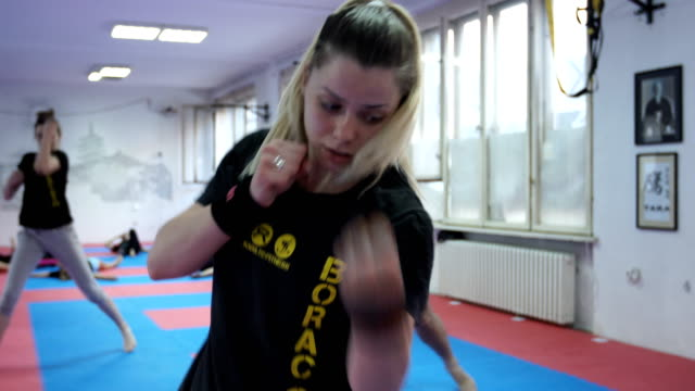 female practicing self defense exercises - self defense stock videos and b-roll footage