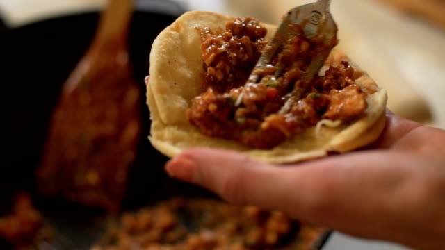 female preparing taco, slo mo - mexican food stock videos & royalty-free footage