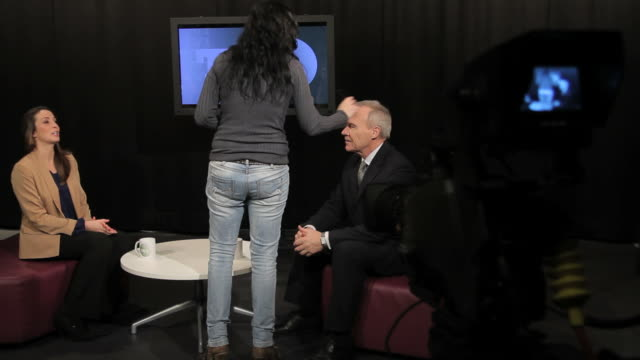 female presenter and guest receiving make up in studio - glee tv show stock videos and b-roll footage