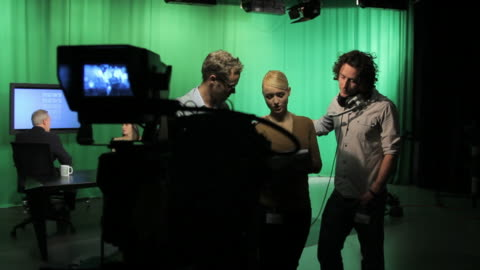 female producer and camera crew discussing - producer stock videos & royalty-free footage