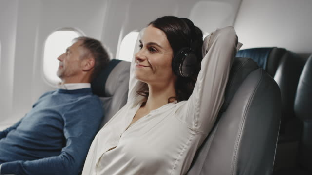 female professional relaxing in corporate jet - hands behind head stock videos & royalty-free footage