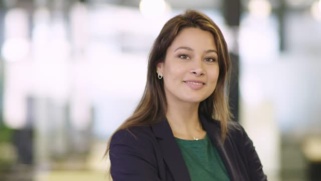 female professional smiling in office - focus on foreground stock videos & royalty-free footage