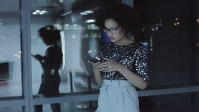 Female professional text messaging on phone