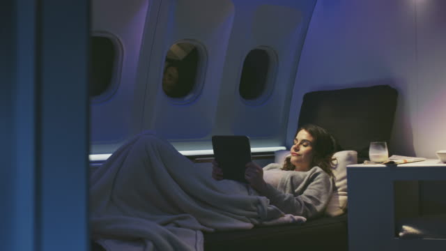 female professional using tablet pc in private jet - business travel stock videos & royalty-free footage