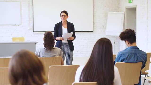female professor giving speech at university - three quarter length stock videos & royalty-free footage