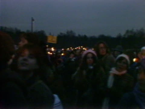 female protestors hold a candle light vigil outside greenham common airbase to protest against the base housing cruise missiles. - berkshire england stock videos & royalty-free footage