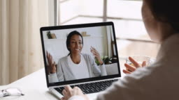 Female psychologist consulting african woman client during online counseling session