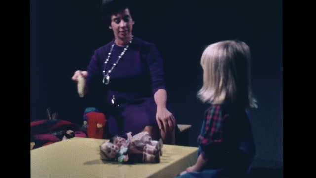 order hd female psychologist giving girl child two dolls girl boy asking to demonstrate 'the boy is washed by the girl' girl taking small cloth girl... - doll stock videos & royalty-free footage