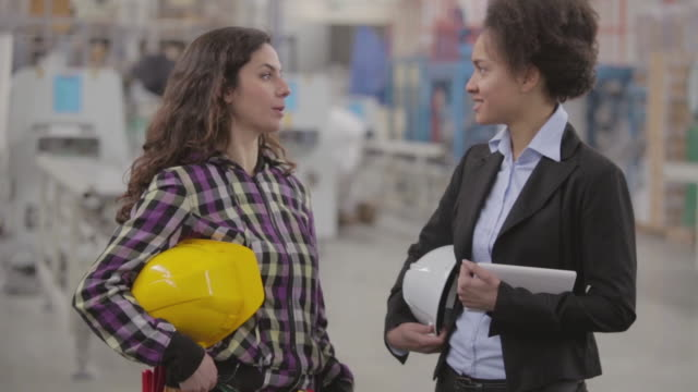 Female quality inspector and female worker talking