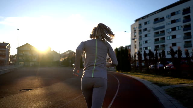 female race runner listening to music - track and field athlete stock videos & royalty-free footage