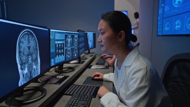 ds female radiologist analysing a head scan - neuroscience stock videos & royalty-free footage