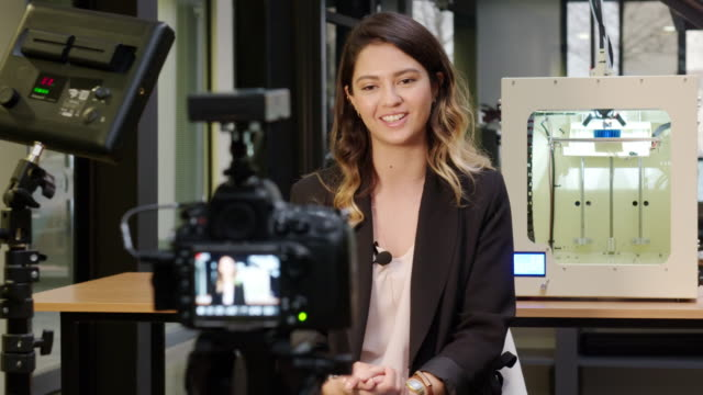 female reporter in a 3d printing office - journalist video stock e b–roll