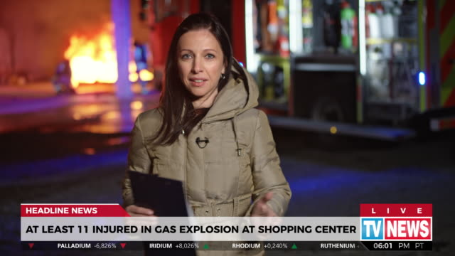 Female reporter reporting from the scene of a gas explosion accident