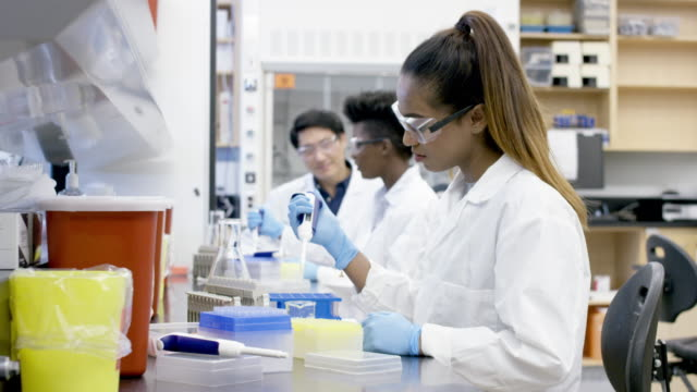 female researcher transfers liquid sample solution - chemistry stock videos & royalty-free footage