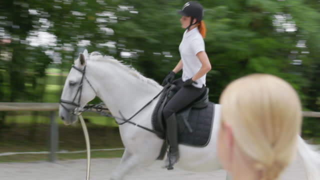 TS Female riding the horse in canter motion