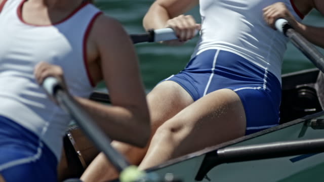 female rowing athletes training in a double scull - scull stock videos & royalty-free footage