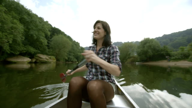 Female rowing boat in lake