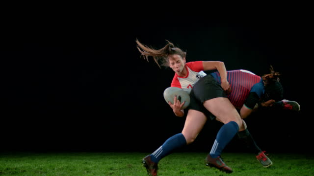 slo mo ld female rugby player bringing her opponent to a stop by tackling her - helmet stock videos & royalty-free footage