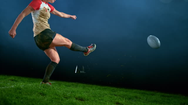 slo mo female rugby player kicking the ball - kicking stock videos & royalty-free footage