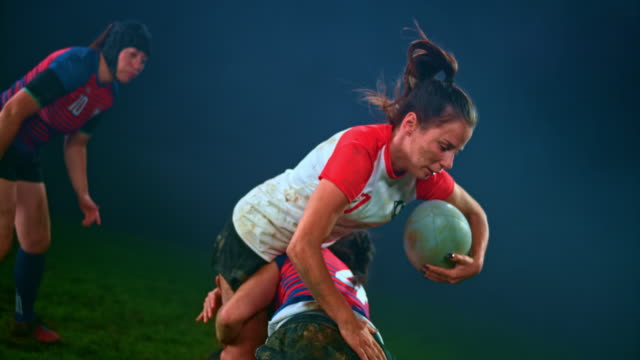 slo mo female rugby player pushing her opponents away but being tackled to the ground - shirt stock videos & royalty-free footage
