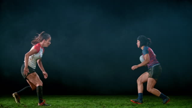 slo mo ld female rugby player tackling her opponent - rugby stock videos & royalty-free footage