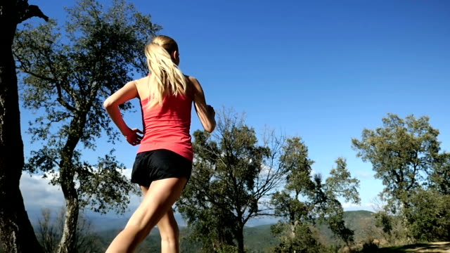 female runner in forest path - running shorts stock videos and b-roll footage
