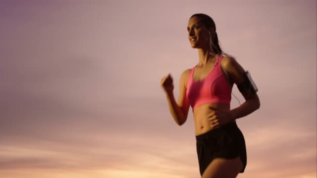 SLO MO Female runner in movement at sunset