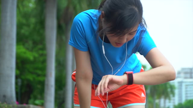 female runner resting - human muscle stock videos & royalty-free footage