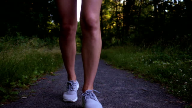 female runner: slow motion - running shorts stock videos and b-roll footage