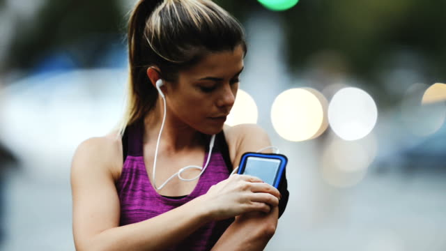 female runner - mp3 player stock videos & royalty-free footage