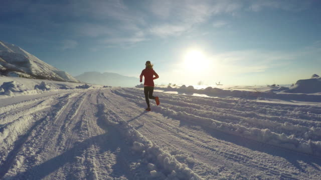 Female Running on Cold Snowy Winter Utah Day