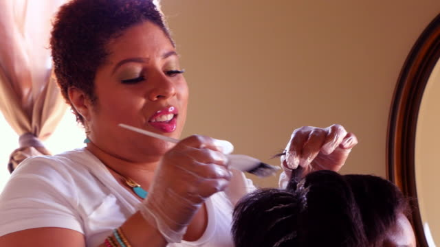 ms female salon owner straightening clients hair in salon - beauty salon stock videos and b-roll footage