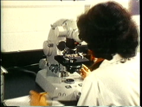 1980 ms zi female scientist conducting lab research with microscope / united states / audio - biologist stock videos & royalty-free footage
