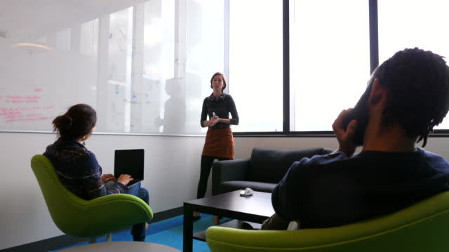 ms female scientist explaining data on whiteboard to colleagues in conference room in research lab - university of washington stock videos & royalty-free footage