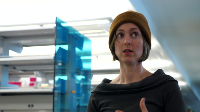 ms female scientist explaining experiment while working in research lab - university of washington stock videos & royalty-free footage