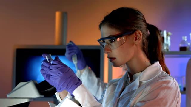 HD DOLLY: Female Scientist Preparing Microscope Slide