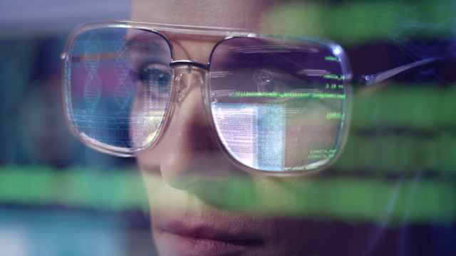 female scientist studying dna mutations. eyeglasses reflection of computer screen - interactivity stock videos & royalty-free footage