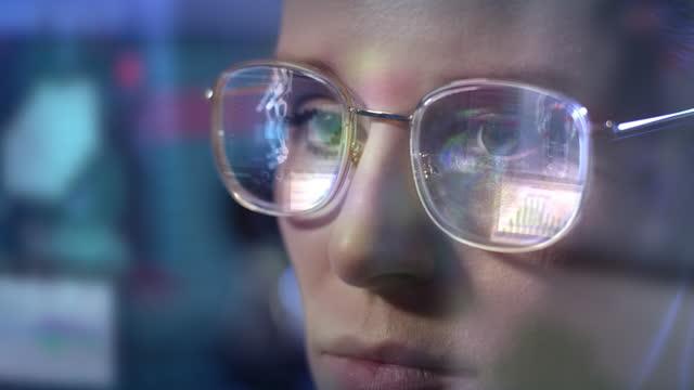 female scientist working on exoskeleton prototype. computer screen reflecting in eyeglasses - female doctor stock videos & royalty-free footage