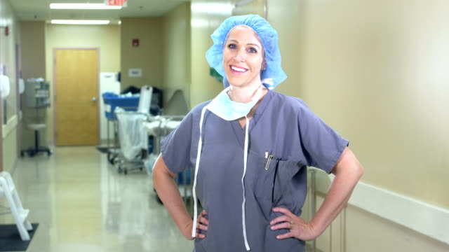 female scrub nurse or doctor - waist up stock videos & royalty-free footage