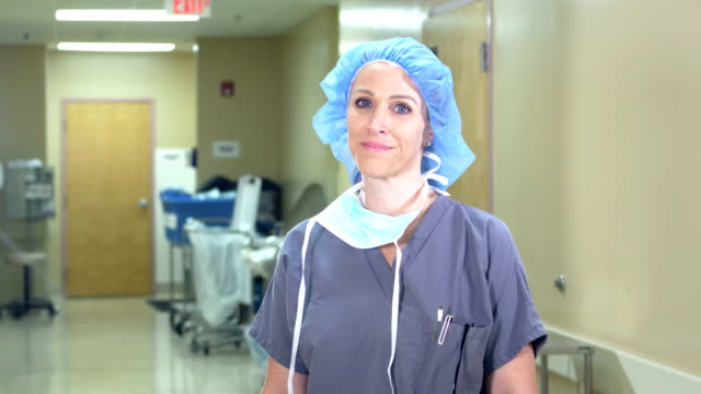 female scrub nurse or doctor - female nurse stock videos & royalty-free footage