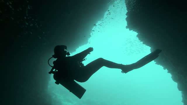 female scuba divemaster guiding people cave daiving thailand - aqualung diving equipment stock videos & royalty-free footage