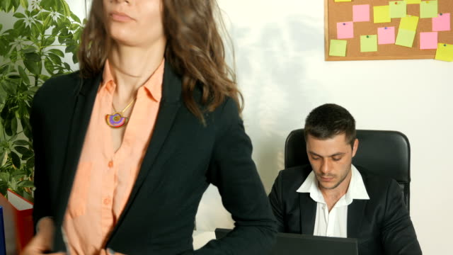 female secretary standing in front of her boss's desk - mini skirt stock videos & royalty-free footage