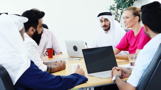 female senior business executive chairing a strategy meeting - middle eastern ethnicity stock videos & royalty-free footage