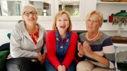 Female senior friends have a video call