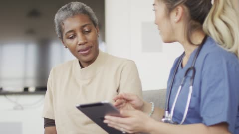 ethnic female senior getting medical check up - patient stock videos & royalty-free footage